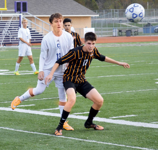 Photo by Ron Johnston Marietta's John Mannix (12) and Chillicothe's Hudson Ward (13) battle for position during a district semifinal soccer match Wednesday at Logan High School.