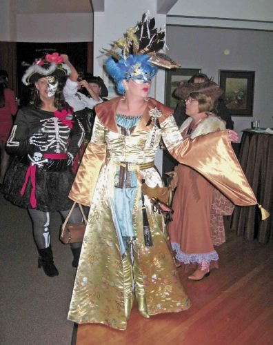 File Photo Linda Smith, left, Veronica Fields, center, and Janie Mancini, right, dance to the music of Qiet during the last MasqueRave at the Parkersburg Art Center in 2014. The event returns Friday from 8-11 p.m. at the art center.
