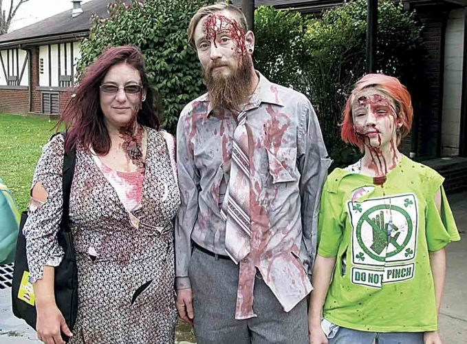 Photo courtesy of Jeremy Miller  Marietta resident Megan Miller, 36, with husband Jeremy Miller, 36, and daughter Rylee Miller, 11, dressed at zombies for the Zombie Walk in Parkersburg on Oct. 15 and plan to attend the Zombie Fest in Marietta this Saturday.