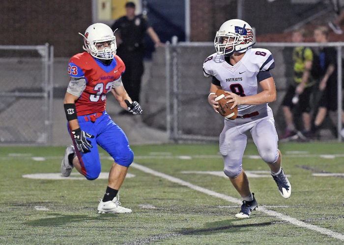 Parkersburg South's Nick Yoho looks for running room during a football game against Morgantown earlier this season.