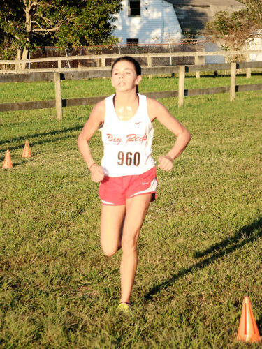 Parkersburg's Ellie Dario will join her fellow Big Red teammates during Saturday's Class AAA state cross country championships at Cabell Midland High School. Photo by Jay W. Bennett.