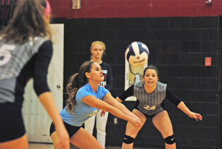 Parkersburg South libero Kassidy Spears passes the ball while teammate Caitlin Miller looks on during the Patriots' senior night Thursday inside the Rod Oldham Athletic Center. Visiting Wheeling Park won the match in five sets. Photo by Jay W. Bennett.