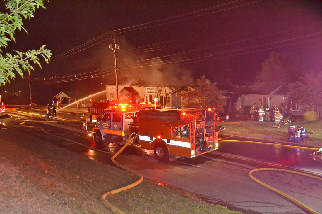 Photo by Brett Dunlap Fire departments from Belpre, Little Hocking, Dunham and Blennerhassett responded around 6 p.m. Thursday to a fire at Metz and Sons General Contractors, 1515 Washington Blvd. in Belpre. The fire destroyed the business and an adjacent home and also damaged other adjacent structures. Washington Boulevard was closed most of the evening.