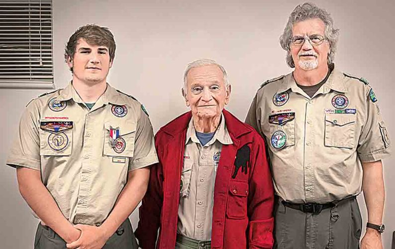 Photo by Jeff Baughan Jesse Osborn, left, received his Eagle Scout award on Nov. 14 as a member of Troop 16 at Lauckport United Methodist Church. With him is Troop 16 Scoutmaster Glenn Miller, center, and his father, Jim Osborn, right, who also received an Eagle Scout award through the troop in 1966.
