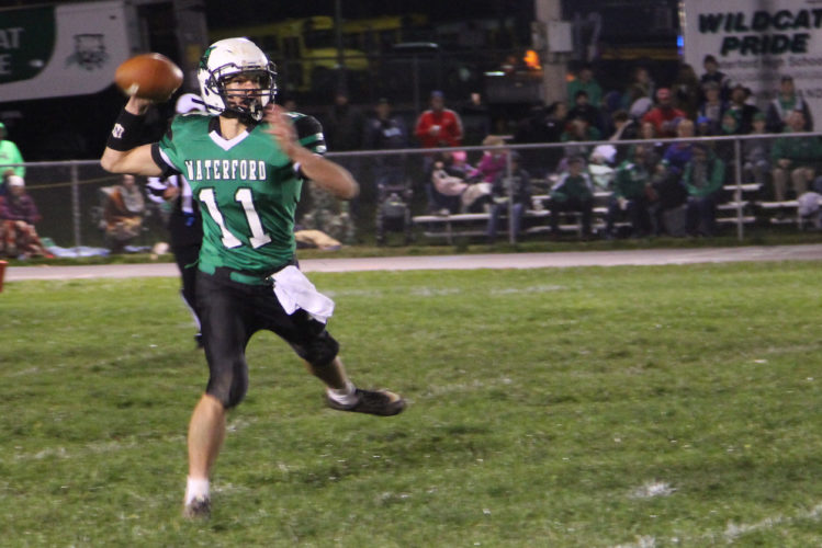 Photo by Tom Perry Waterford's Isaac Huffman (11) looks to pass during a high school football playoff game this season.
