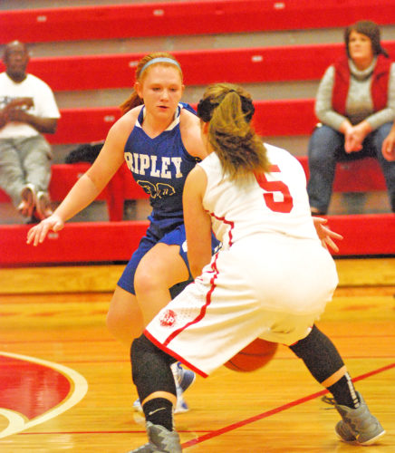 Parkersburg's Pheobe Hayes (5) is guarded by Ripley's Jaelyn Hunt (30) during a girls basketball game at PHS Friday night won 79-37 by the host Big Reds. Photo by Steve Hemmelgarn.