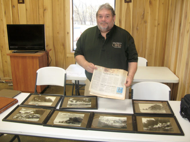 Photo by Evan Bevins Greg Smith displays photos from the attack on Pearl Harbor and a newspaper detailing plans for the 50th anniversary celebration in 1991 at his Williamstown business, Henderson Wilds. As an Air Force major stationed in Hawaii, Smith helped plan and coordinate the anniversary activities 25 years ago.
