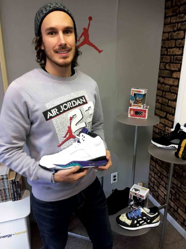 "Photo Provided Comics and Kicks owner Daniel Najar displays the ""dead-stock"" pairs of Nikes the store carries. Comics and Kicks also offers collectibles, jerseys and sports memorabilia."
