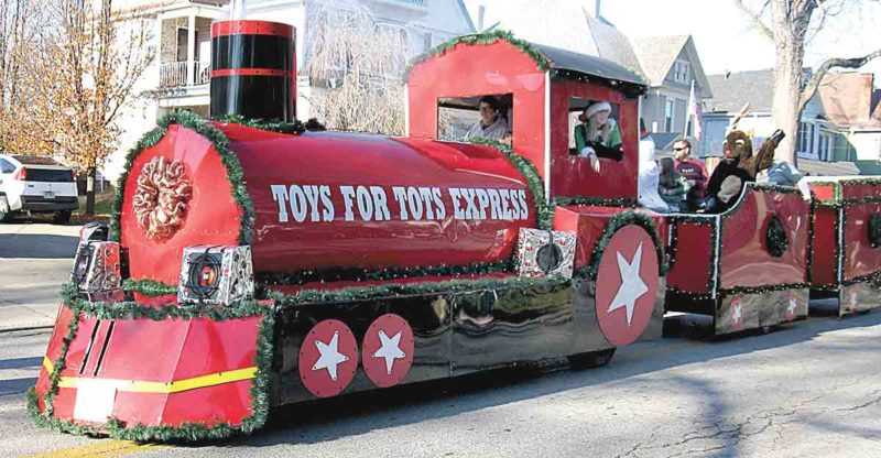 File Photo The Toys for Tots Express travels along Market Street during last year's Parkersburg Christmas Parade. This year's event will be 2 p.m. Dec. 10 in downtown Parkersburg.
