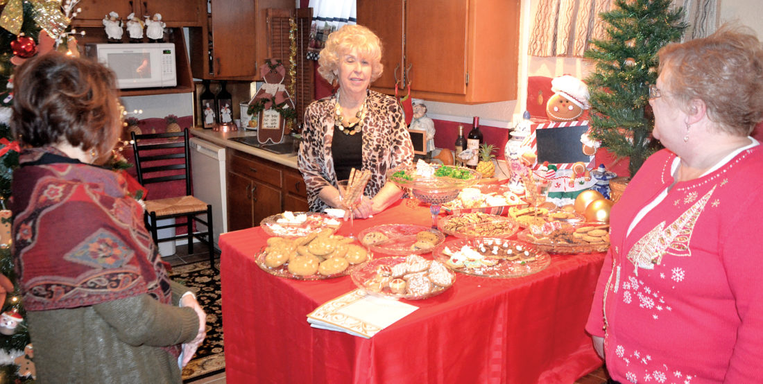 Photo by Brett Dunlap Sarah Witte offers refreshments to visitors Sunday during the Holly Trail Tour of Homes. Witte's home at 3400 Foley Dr., Parkersburg, was one of the homes featured on the annual holiday tour.