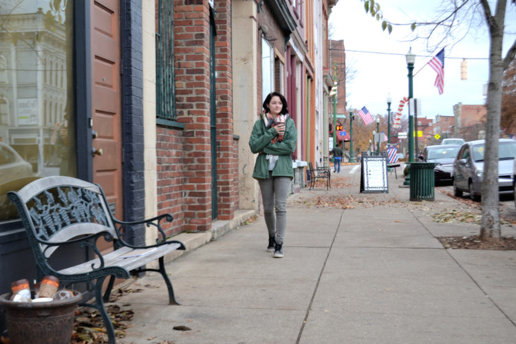 Photo by Peyton Neely Marietta resident Brittani Wright, 21, walks down Front Street on a recent windy afternoon.