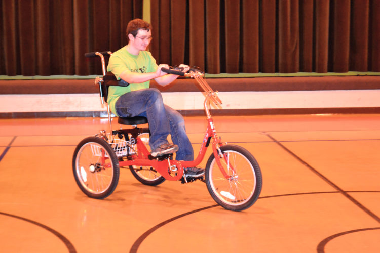 Photo by Peyton Neely Daniel Jenks, 15, of Lower Salem, rides around on the new AmTryke adaptive tricycle at Ewing School in Marietta.