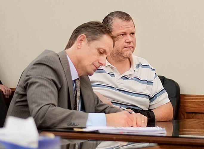 Russell S. Burkhammer Jr., 44, right, of 1023 Third St., Marietta, awaits sentencing in Washington County Common Pleas Court on Monday. (Photo by Hannah Kittle)