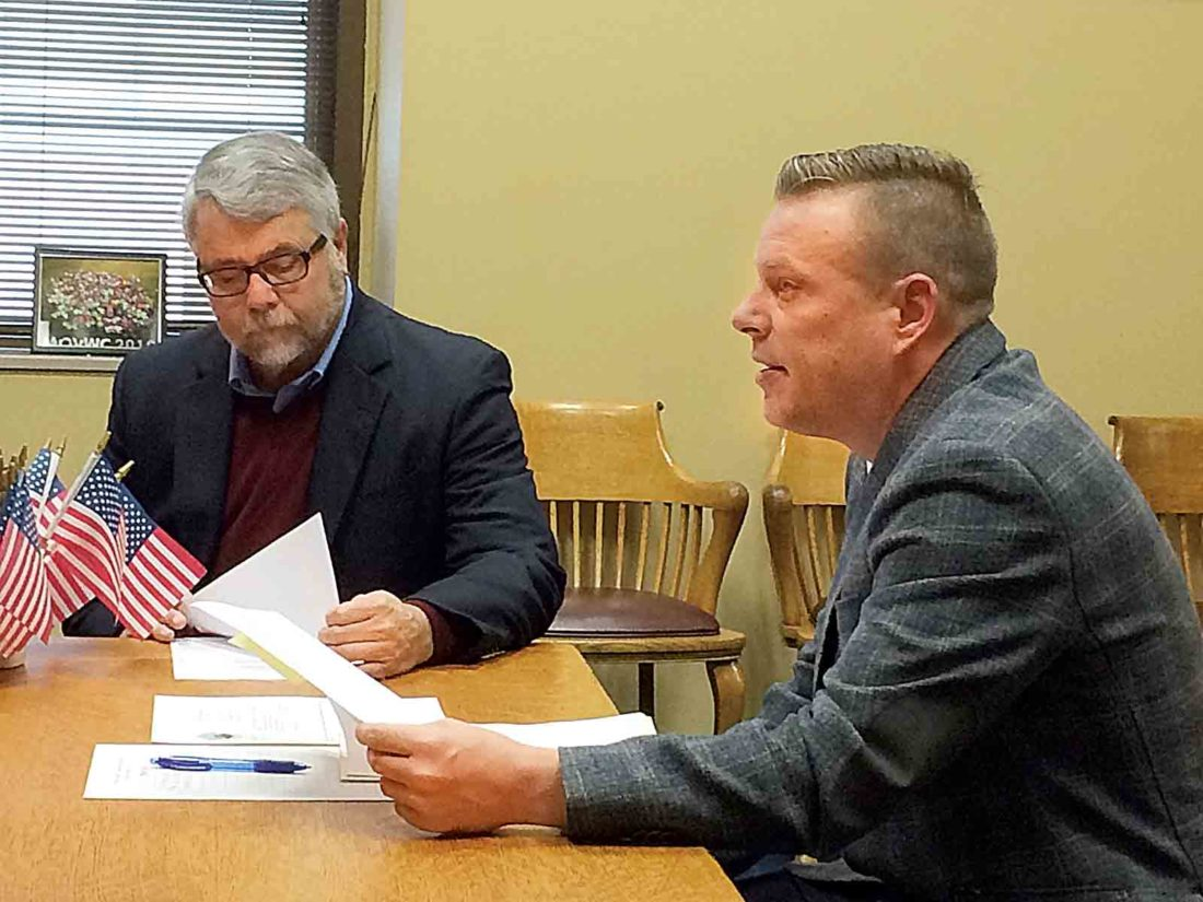 Mark Lewis, left, and Derek Fleming of the Greater Parkersburg Convention and Visitors Bureau appeared before the Wood County Commission on Monday and received approval for a $3,000 Innovative Programming Grant for the Duals Wrestling Tournaments that will be held locally in January. (Photo by Brett Dunlap)
