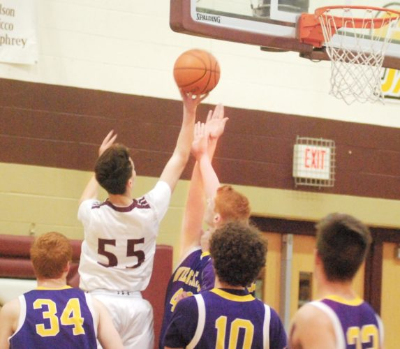 Photo by Mike Morrison Williamstown's Isaac Brown, who scored a game-high 24 points,  goes up for a shot over Wood County Christian's Luke Spencer Tuesday during the Yellowjackets' 76-37 win over the Wildcats.
