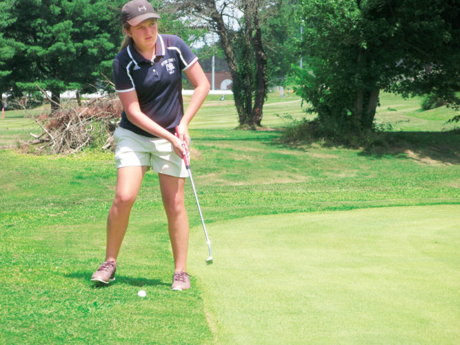 Photo by Jay W. Bennett Ritchie County's Sydney Brill, pictured here taking a practice stroke during a match earlier this year in St. Marys, will continue her golf career and education at Fairmont State University.