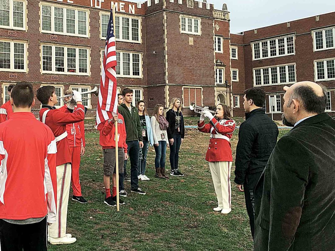 Buglers Ayden Nutter, left, and Abby Smith, right, play Taps during the closing moments of a Pearl Harbor Remembrance Day ceremony Wednesday morning at Parkersburg High School. (Photo by Michael Erb)