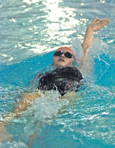 Parkersburg junior Kate Snider turned in a victorious time of 1:06.68 on Wednesday evening at the YMCA to best the field in the 100 yard backstroke. Photo by Jay W. Bennett.