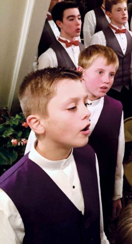 The Smoot Theatre Youth Vocal Ensembles will present a Christmas Concert at 4 p.m. Saturday at Trinity Episcopal Church in Parkersburg. Among the performers will be Brayden Deuley, left front, and Sam Chidester, right front, with the Smoot Theatre Children's Chorus, and Andrew Shaw, left back, and Landon Fowler, right back, members of the Smoot Theatre Boys Ensemble. (Photo Provided)
