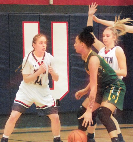 Parkersburg South's Devin Hefner (14) and Lexi Moore (12) guard Huntington's Jordyn Dawson Thursday night during the Patriots' 82-80 win over the Highlanders. (Photo by Steve Hemmelgarn)