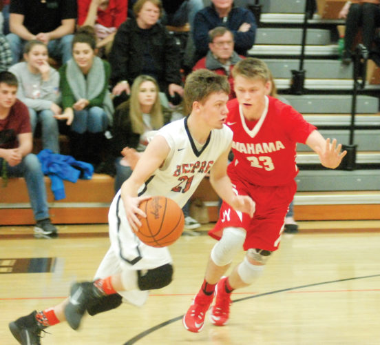 Belpre's Mythius Houghton (21) tries to get past Wahama's Travis Kearns (23) during a high school basketball basketball game Friday. Photo by Mike Morrison.