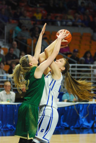 File photo Gilmer County's Riley Fitzwater, right, goes up for a basket during the Class A state championship game last season.