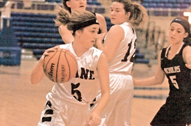 Roane County's Danielle Godbey looks for a lane to the basket against Nicholas County during the Grizzlies' 59-39 victory over the Raiders in the Class AA finals of the I.O.G.A. Classic Saturday at Glenville State's WACO Center. Photo by Joe Albright.