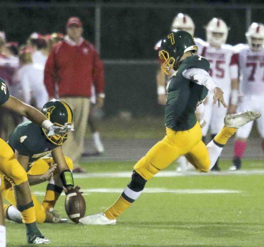 Courtesy photo Huntington's Cason Kessinger attempts a field goal kick during a high school football game this season.