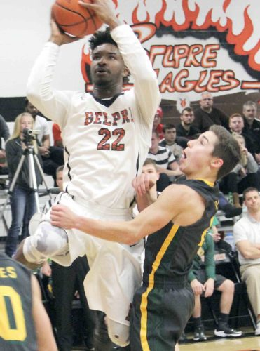 Photo by Tom Perry Belpre's Deijon Bedgood (22) goes up for a basket during a high school boys basketball game against Eastern Tuesday night. Belpre won, 74-58. Bedgood finished with 30 points.