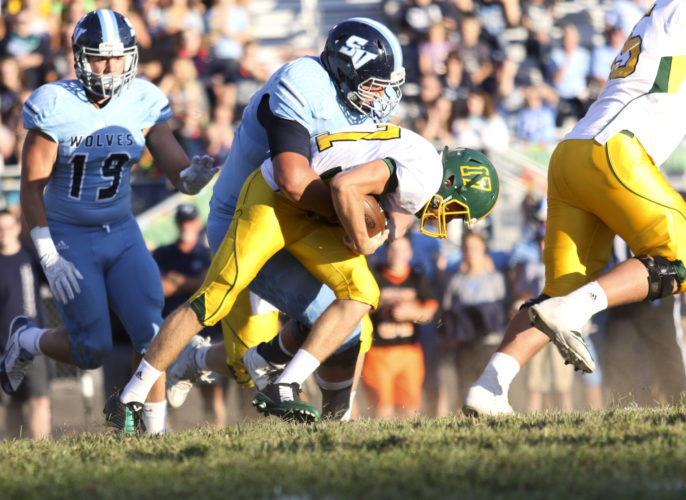 Huntington quarterback Luke Zban (17) is brought down by Spring Valley's Riley Locklear (75) during West Virginia high school football on Friday, Sept. 2, 2016, at Spring Valley High School. Locklear, a University of Tennessee commit, was the recipient of the 2016 Stydahar Award, given to the state's top interior lineman by the West Virginia Sports Writers Association. Photo by Larry Butcher, The Herald-Dispatch.