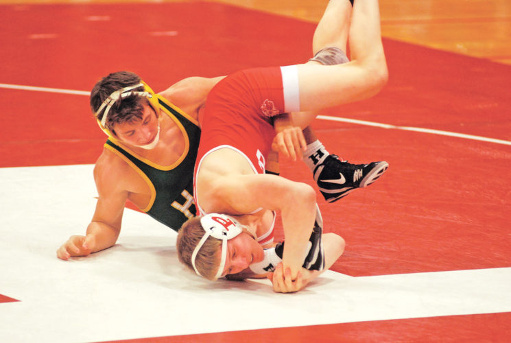 Huntington's Will Jeffers led 9-4 early in the third against Parkersburg's Jared Donahue in their 138-pound match Thursday night inside Memorial Fieldhouse, but the Big Red rallied for a pin in 4:32 to emerge victorious. This was a rematch of last year's Class AAA 132-pound state championship which Donahue won 10-4. Photo by Jay W. Bennett.