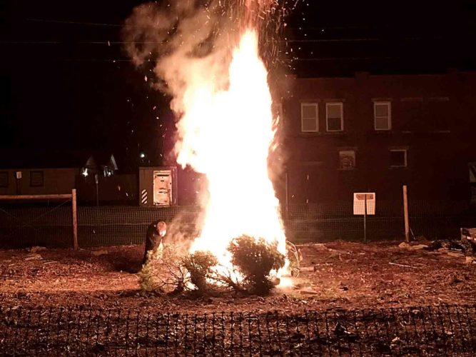 Photo Provided  Senior Pastor Ian B. Reid of the First Lutheran Church ignites a bonfire following the Epiphany Service in 2015. This year's Epiphany Service and bonfire will be held 7 p.m. Jan. 6.