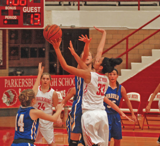 Parkersburg's Breanna Wilson (33) shoots a floater while teammate Alex Delozier (24) looks on earlier this season in a game against Warren. Photo by Jay W. Bennett.