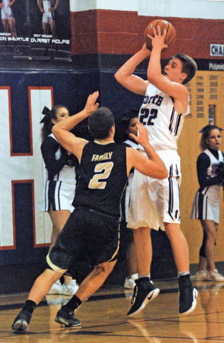 Parkersburg South's Shane Snider (22) goes up for a shot as University's Clay Bailey (2) defends in Tuesday night's game at South won by the visiting Hawks, 60-54. Photo by Steve Hemmelgarn.