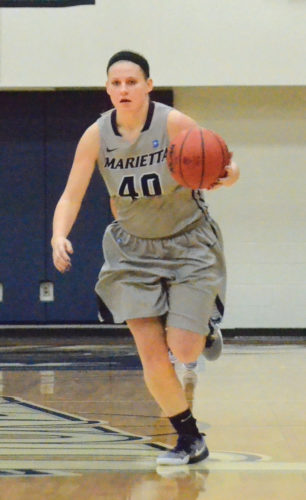 Marietta College's Corrie Burkhardt brings the ball up the court during a college women's basketball game against Muskingum Wednesday at Ban Johnson Arena. Photo by Stacy Nichols.