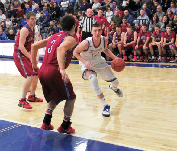 Photo by Tom Perry Warren's Josh Hoffman looks to drive to the basket as Fort Frye's Casey Lewis applies pressure.