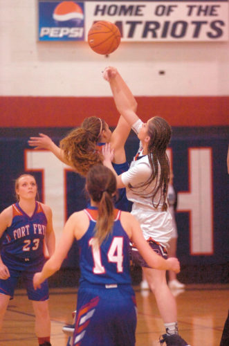 Photo by Joe Albright Parkersburg South's Devin Hefner battles for the opening tipoff against Fort Frye's Makayla Liedtk during the Patriots' 48-39 win over the Cadets earlier this season.