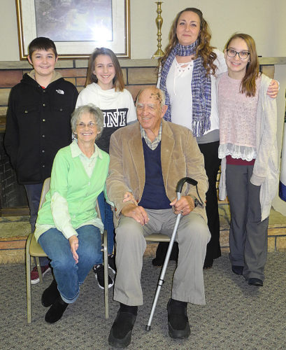 Photo by Jeffrey Saulton A reception for former Wood County Sheriff Ken Merritt was held Thursday at the Woman's Club in Williamstown. With him are his wife, Linda, seated next to him. Rear, grandson Dominic Babcock, granddaughter India Merritt, daughter Lenita Babcock and granddaughter Debria Babcock.