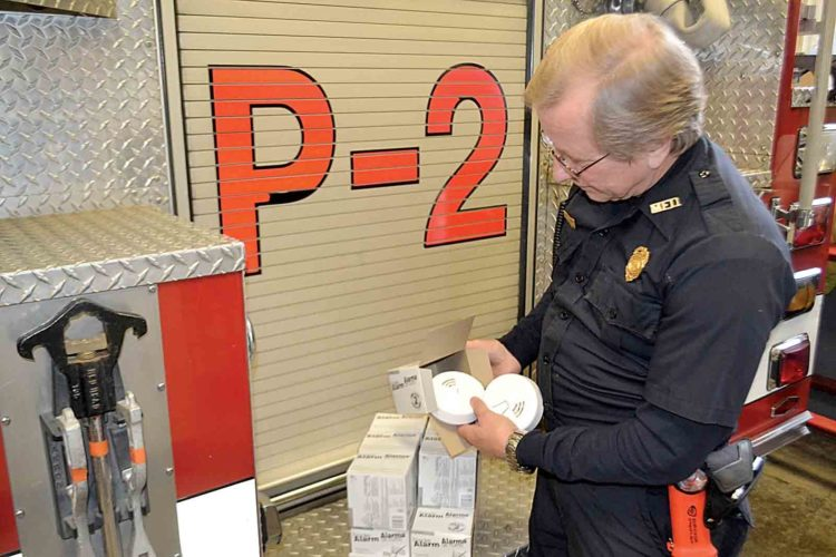 Photo by Peyton Neely Capt. Jack Hansis of the Marietta Fire Department checks on the smoke detectors free to the public at the fire house Thursday afternoon.