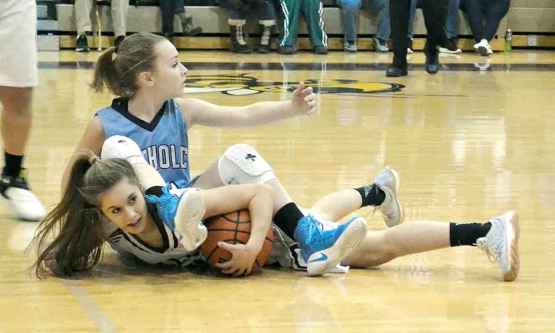 Photo by Ron Johnston Williamstown's Ashley Morris, bottom, and Parkersburg Catholic's Madeline Huffman battle for a loose ball during a high school girls basketball game Friday night. Catholic won, 70-55.