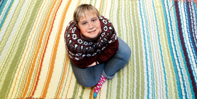 Photo by Jeff Baughan Mary Catherine Augstkalns, of Vienna, used 366 days of noon time weather information to crochet her nine-color blanket.