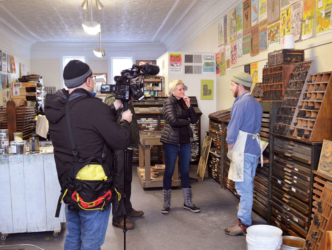 Photo by Doug Loyer Bobby Rosenstock, of Just A Jar Design Press, was filmed in an interview by Amanda Brinkman of the Small Business Revolution this weekend in Marietta.