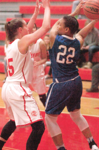 Parkersburg's Madi Mace smothers Capital's Danijah Allen during the Big Reds' 91-51 victory over the Cougars Tuesday night inside PHS Memorial Fieldhouse. Mace paced the Big Reds with 19 points on the night. Photo by Joe Albright.