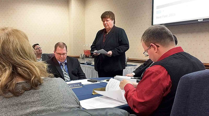 Photo by Brett Dunlap West Virginia University at Parkersburg Chief Financial Officer Alice Harris addresses the Board of Governors Wednesday about proposed cuts from the state and the school's policy of requiring students to pay before they start attending classes.