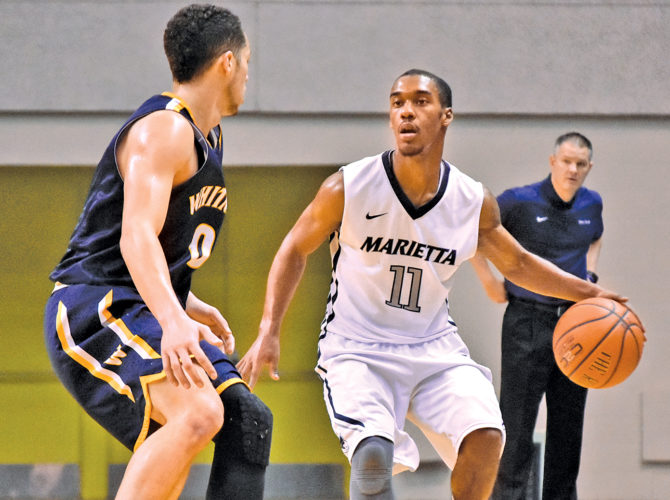 Marietta College's Keith Richardson looks to pass during a college basketball game earlier this season. Richardson scored 30 points to help the Pioneers beat Mount Union Wednesday.