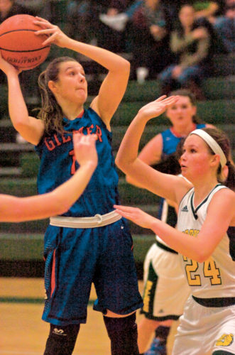 Gilmer County's Abby Gwinn looks to shoot while receiving pressure from Doddridge County players earlier this season. Photo by Joe Albright.