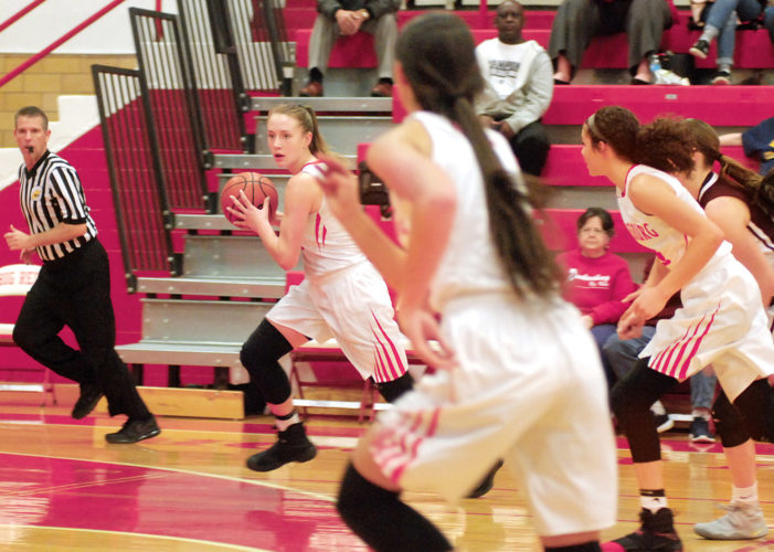 Photos by Steve Hemmelgarn Parkersburg's Madi Mace runs the fast break while teammates Shay-Lee Kirby (far right)and Hannah Carroll (right center)run the floor with her Thursday night during the Big Reds' 101-38 win over visiting Woodrow Wilson.