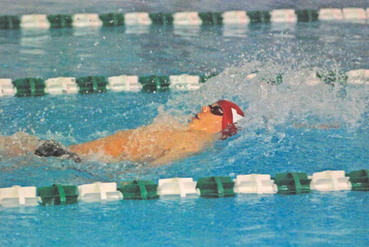 Parkersburg's David Snider speeds through the water en route to posing a winning time of 56.12 in the 100 backstroke during Saturday's Parkersburg Penguin Invitational at the YMCA. Photo by Steve Hemmelgarn.