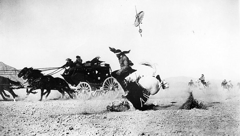 "Photo Provided Yakima Canutt is shot by John Wayne in this spectacular horse fall from ""Stagecoach."""