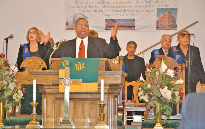 Photo by Brett Dunlap Zion Baptist Church Pastor Charles Grays spoke Sunday during a special service commemorating the legacy of the Rev. Dr. Martin Luther King Jr. at the church. Many people of different faiths and backgrounds came together for the service.
